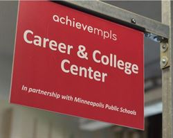 a door sign that reads achieve mpls career and college center