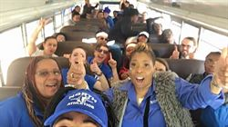 Proud Fans on the Fan Bus!