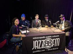 two students, Mayer Frey, Jimmy Jam and Terry Lewis sitting together at a table with microphones