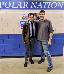 Radio teacher and Mayer Jacob Frey stand together in the hallway of North High